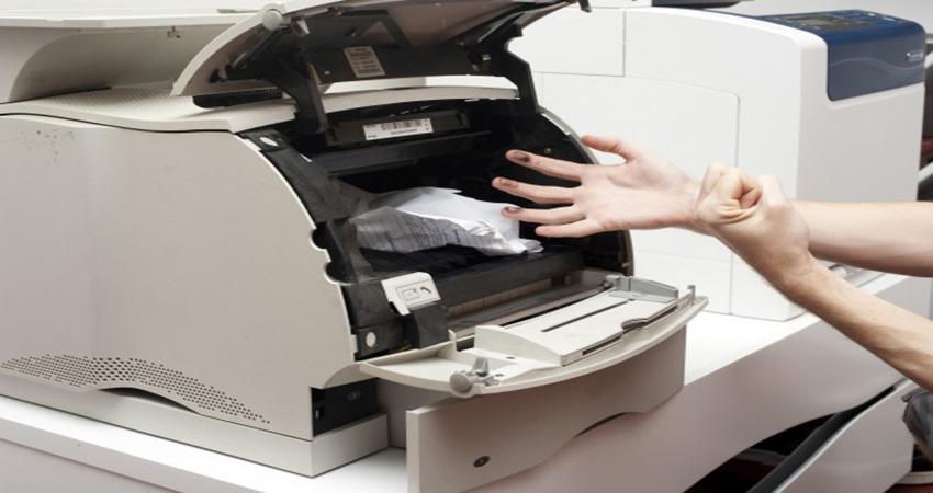 Mực tràn ra ngoài máy photocopy phải làm sao? 1